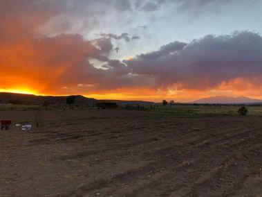Sisnaajini, sacred mountain of the Navajo (Dine), on the far horizon at sunset.